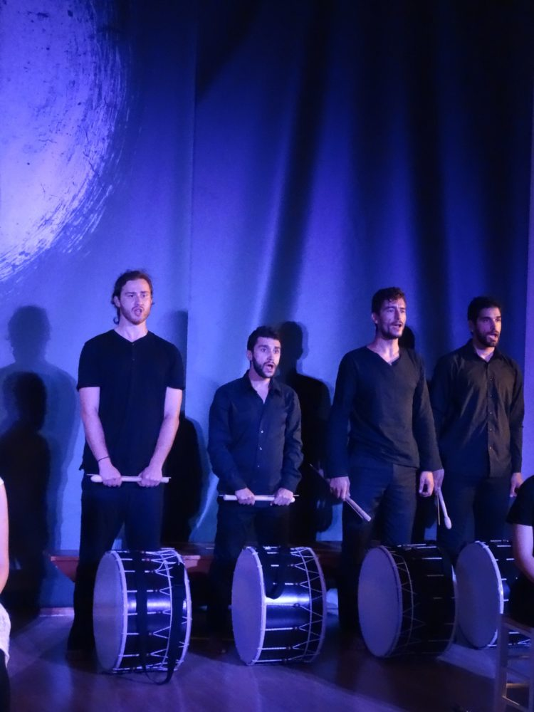 Four of Milia's Brothers; a moment from the premier of AMILITI on Paxos Festival stage