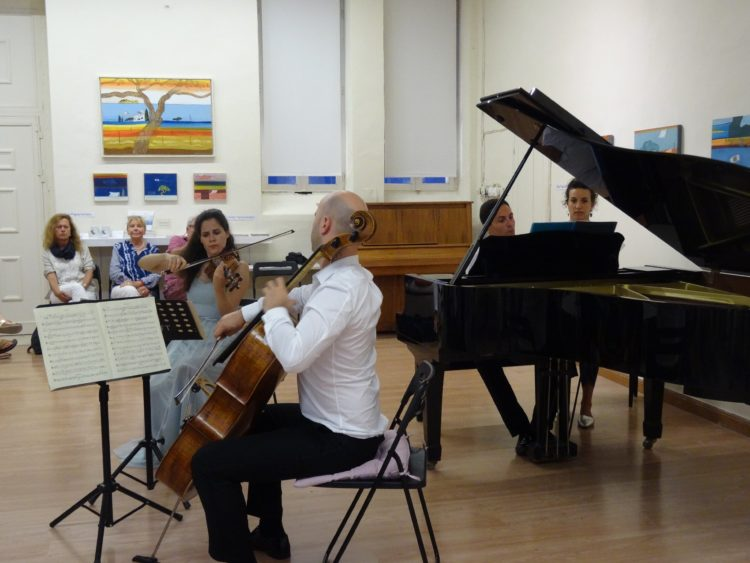 Trio Papadopoulos: Dimitre-Stephane Papadopolos on the piano, Marie-Claudine Papadopoulos on the violin and Vay.. on the cello offering us a very emotional performance